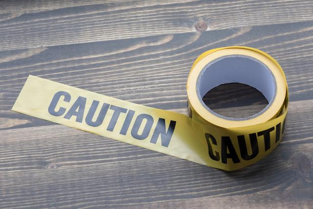 yellow caution tape on a wooden background. Safety Barrier For Police Barricade, For Contractors