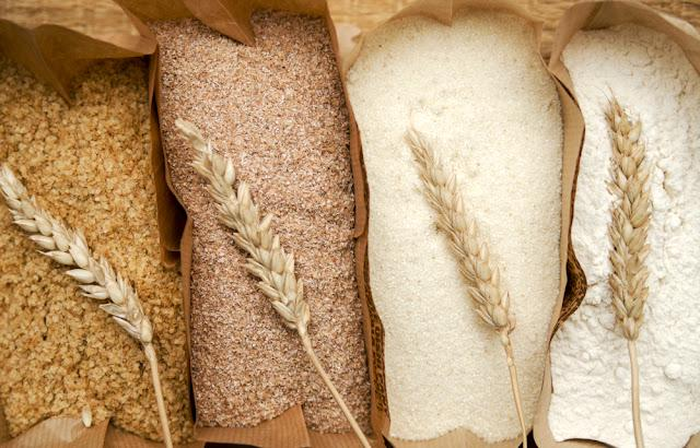 Different flour of wheat cereal in bakery bags.Texture of four wheat in mill:milled wheat sprouts, wheat bran,semolina flour,durum.Top view