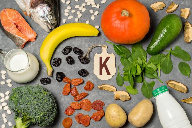 Food is source of potassium. Various natural food rich in vitamins and micronutrients. Useful food for health and balanced diet. Prevention of avitaminosis. Small cutting board with name of potassium