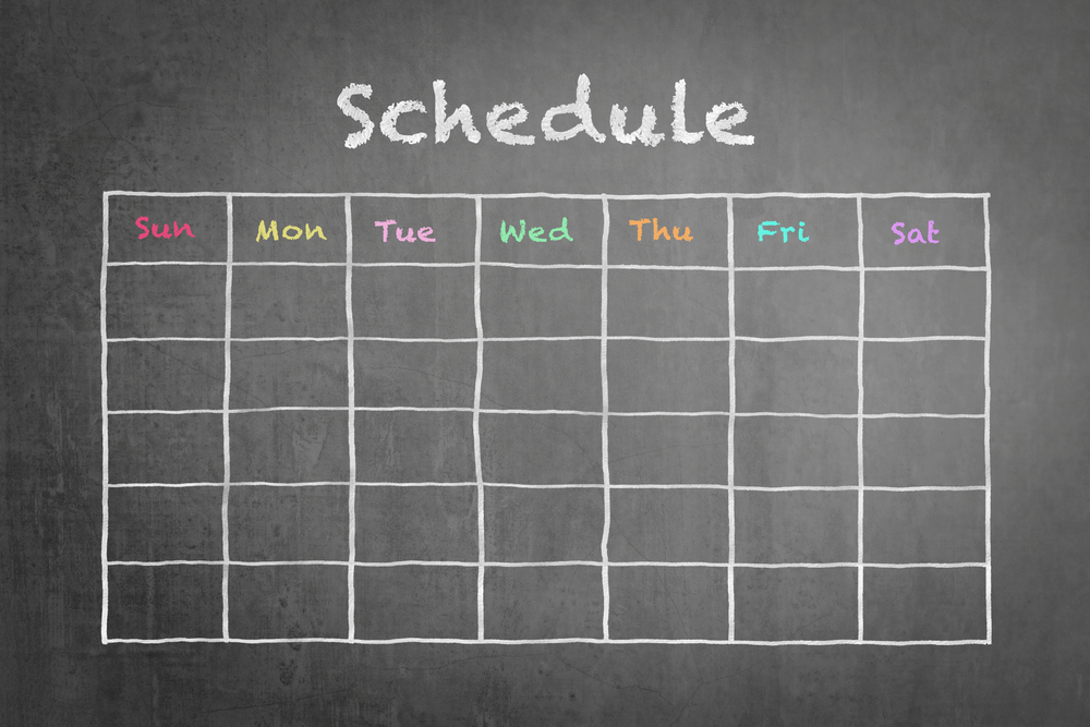 Schedule with grid time table on black chalkboard background